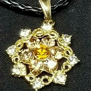 Faux costume jewelry flower rhinestone pendant